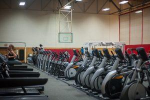 Photo of the Natatorium Cardio Court showing rows of treadmills and elliptical machines