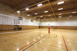 Photo of the Natatorium indoor volleyball courts.