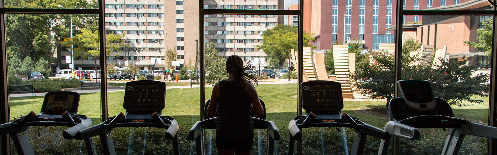 Woman running on treadmill at Ogg Hall Fitness Center