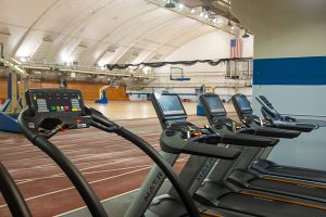 Photo of a row of empty treadmills lining the running track at the Shell