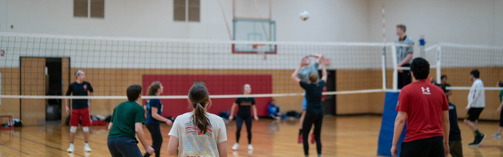 Photo of an intramural indoor volleyball game being played at the Natatorium courts
