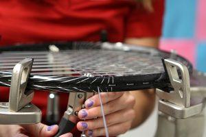 Photo of a tennis racquet being restrung