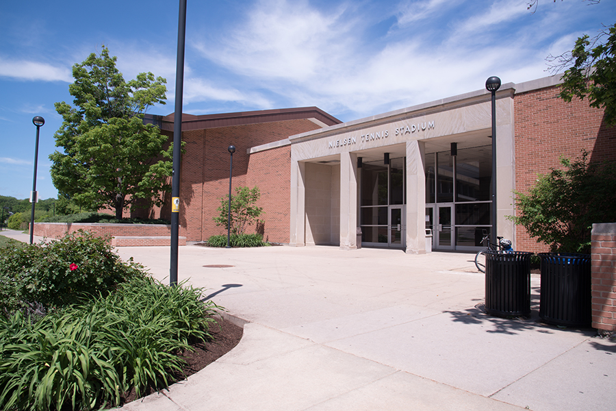 Photo of the Nielsen Tennis Stadium front entrance outdoors