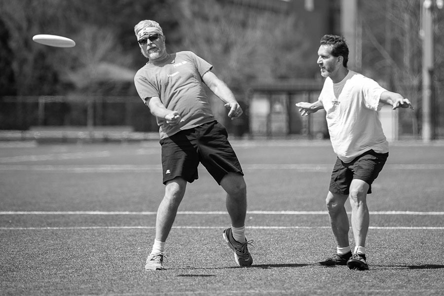 black and white photo of two ultimate participants playing on opposing teams at near west fields