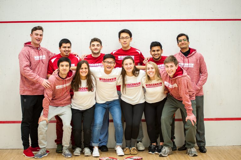 Photo of the UW Golf Team standing together wearing matching Wisconsin apparel