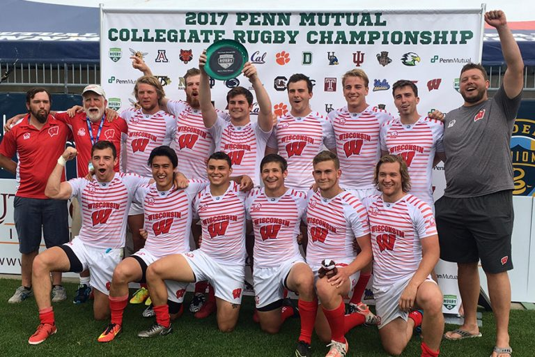 Photo of the UW Men's Rugby team standing together in matching uniforms at the Collegiate Rugby Championship