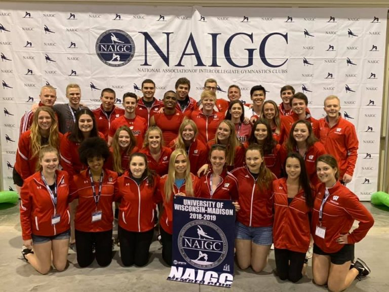 Photo of the UW gymnastics team posing together at the NAIGC conference