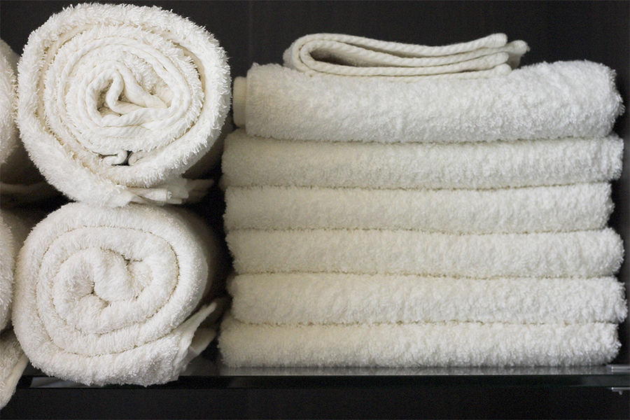 Photo of white towels stacked neatly