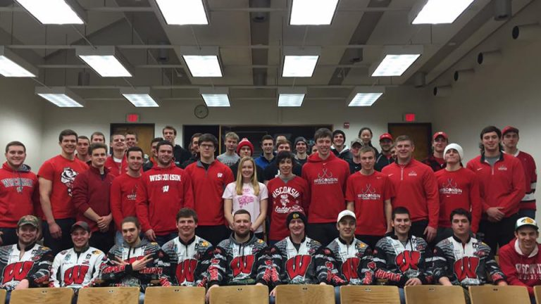 Photo of the UW Fishing team standing together wearing Wisconsin apparel