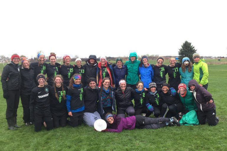 Photo of the UW women's ultimate frisbee team standing together on an outdoor field