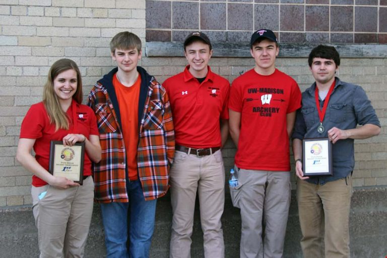 Photo of the UW Archery team standing together holding plaques