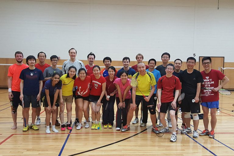 Photo of the UW Badminton Sport Club standing together in an indoor gym