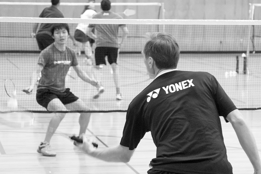 black and white image of two badminton players