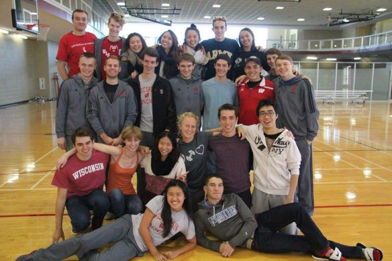 Photo of the UW Fencing Team standing together in an indoor gym