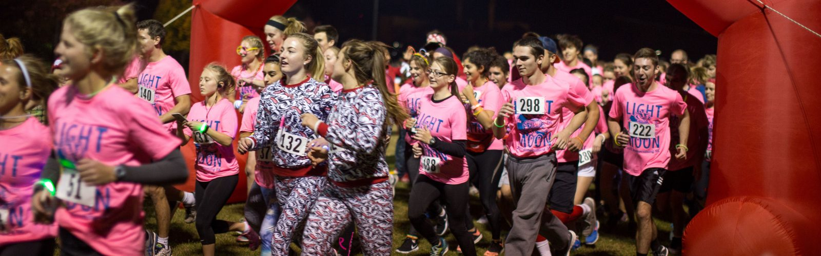 students running in the light of the moon 5K race