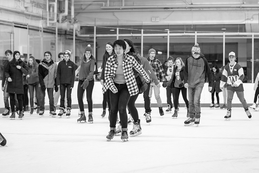 black and white image of a large group of ice skaters