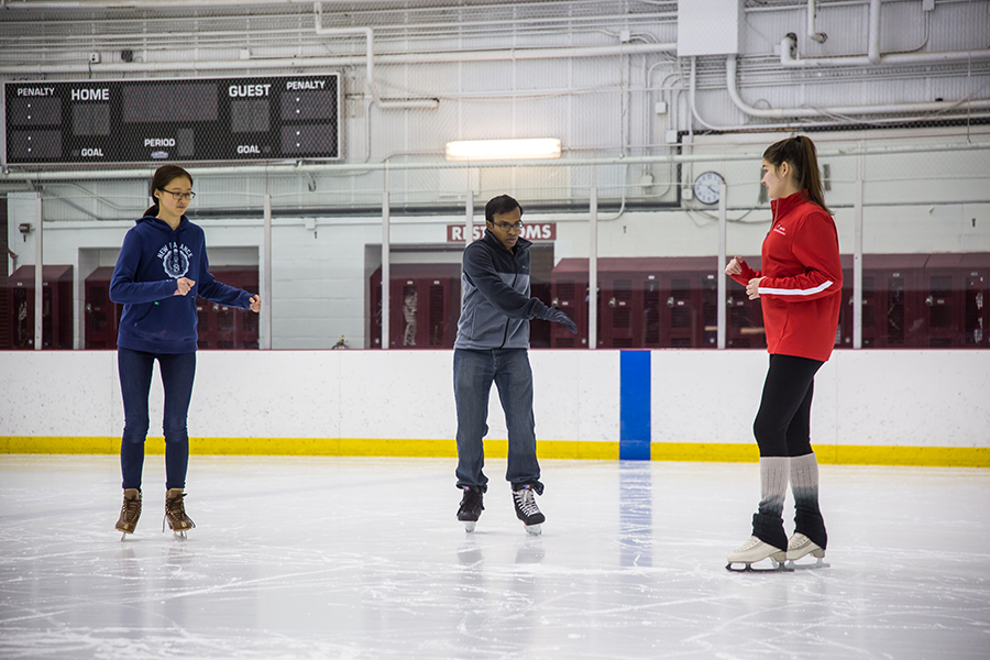 photo of a semi-private skate lesson with instructor and two students