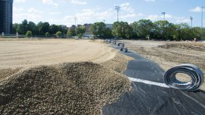 Photo of construction occurring on the Near West fields as the turf system is applied
