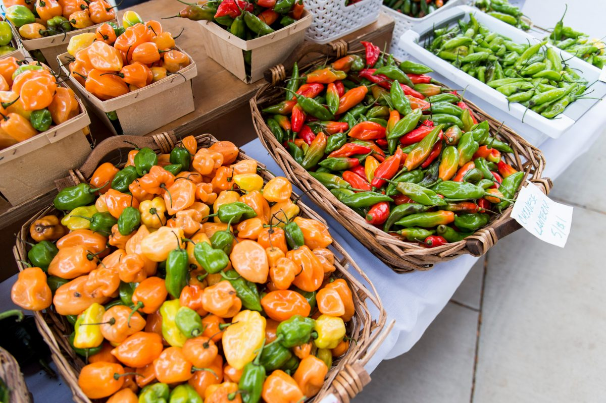 A photo of peppers for sale at the farmers market.