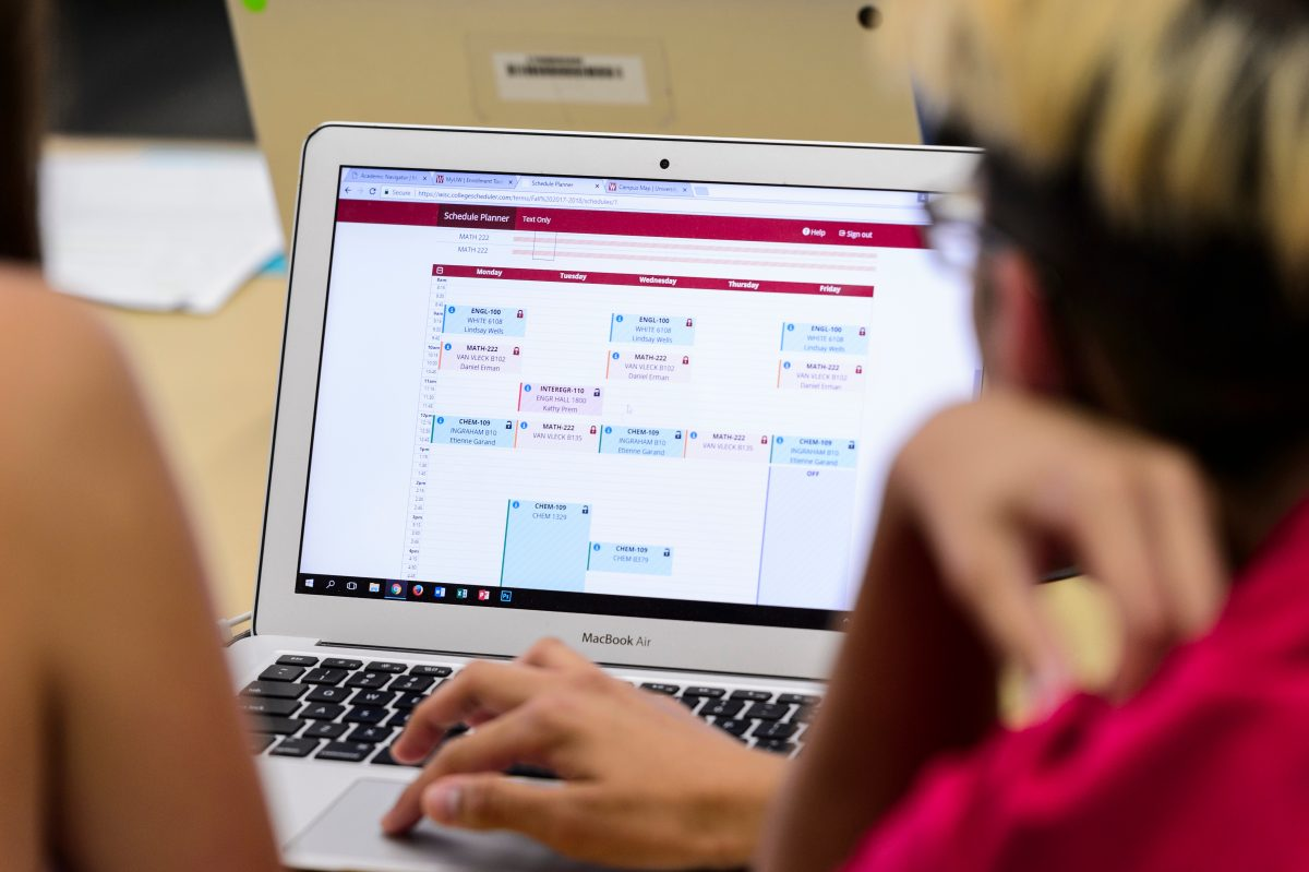 An image of a student looking at their computer screen with a calendar on it