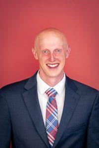 A headshot photo of Aaron Hobson
