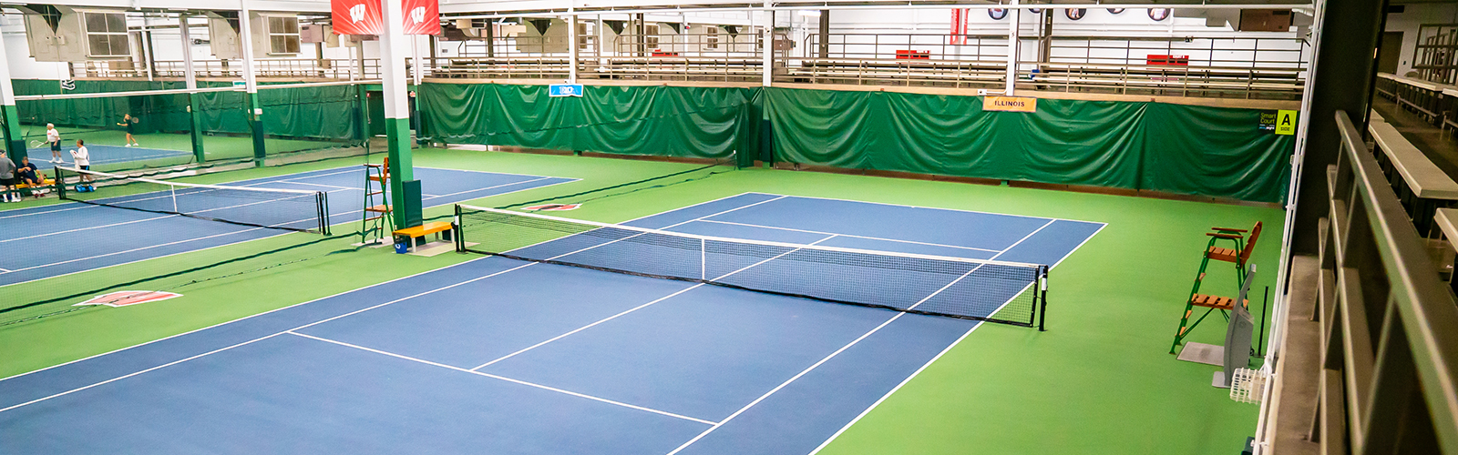 A photo of a blue and green tennis court at Nielsen Tennis Stadium