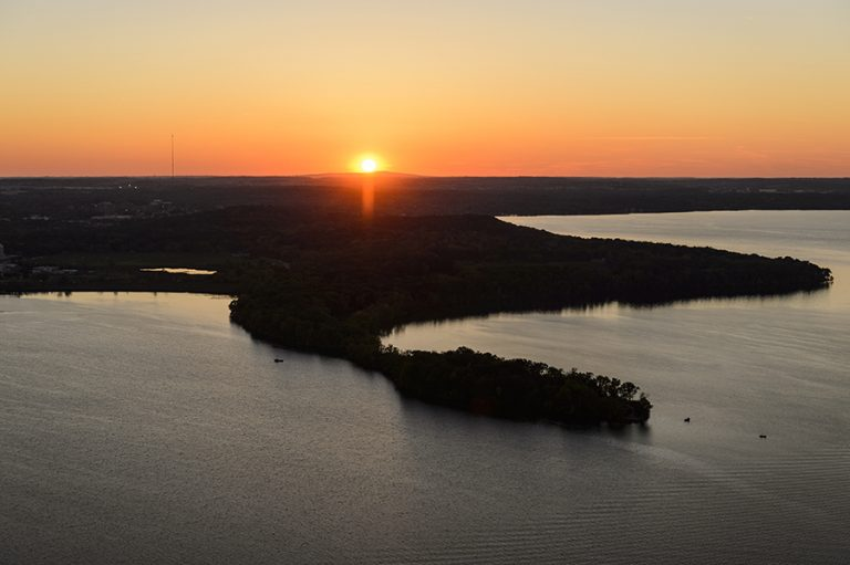 An image of the sunset over Picnic Point and Lake Mendota