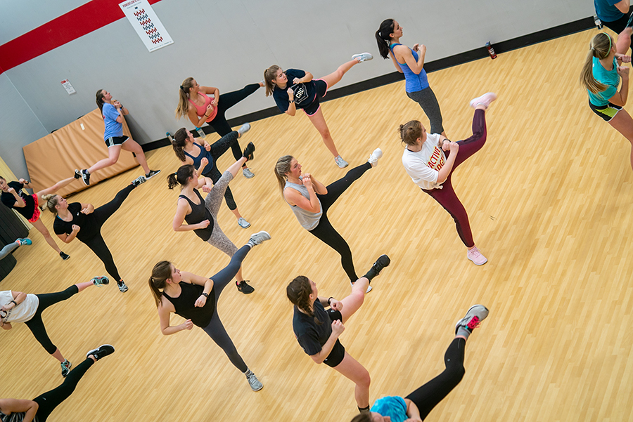 A photo of a group of participants taking a kickboxing intervals class