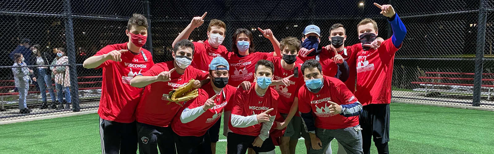 Photo of a group of students after winning a kickball game.